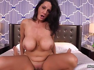 Experienced brunette beside massive milk jugs is riding a rock hard cock, free of any charge