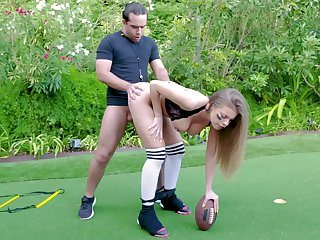Football fanatic Britney Amber sheds protective gear to fuck outside