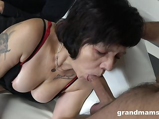 Several sex-starved guys fuck mouth together with pussy of tart granny in red stockings