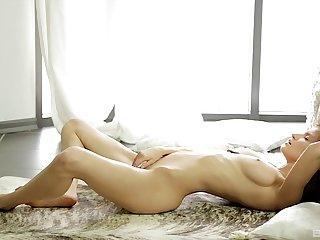 Sweet brunette model Nika drops her clothes to play involving her slit