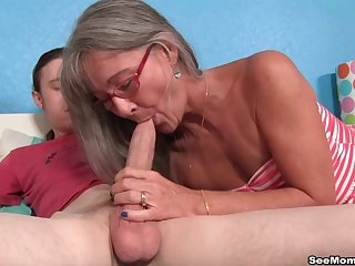 In the buff mature shakes cock in her mouth